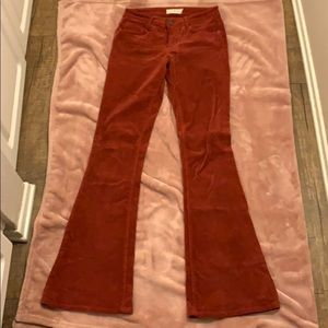 Red corduroy bell bottom jeans